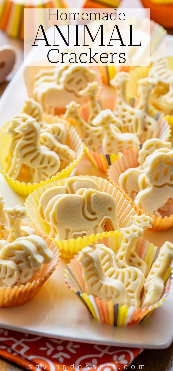 A platter of homemade animal crackers in decorative muffin cups