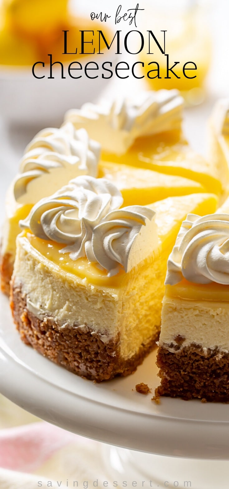 A sliced lemon cheesecake topped with lemon curd