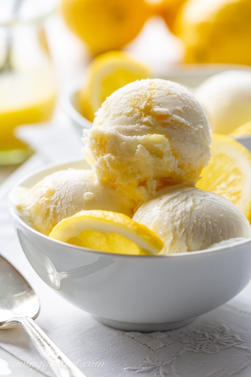 A close up of scoops of ice cream with lemons