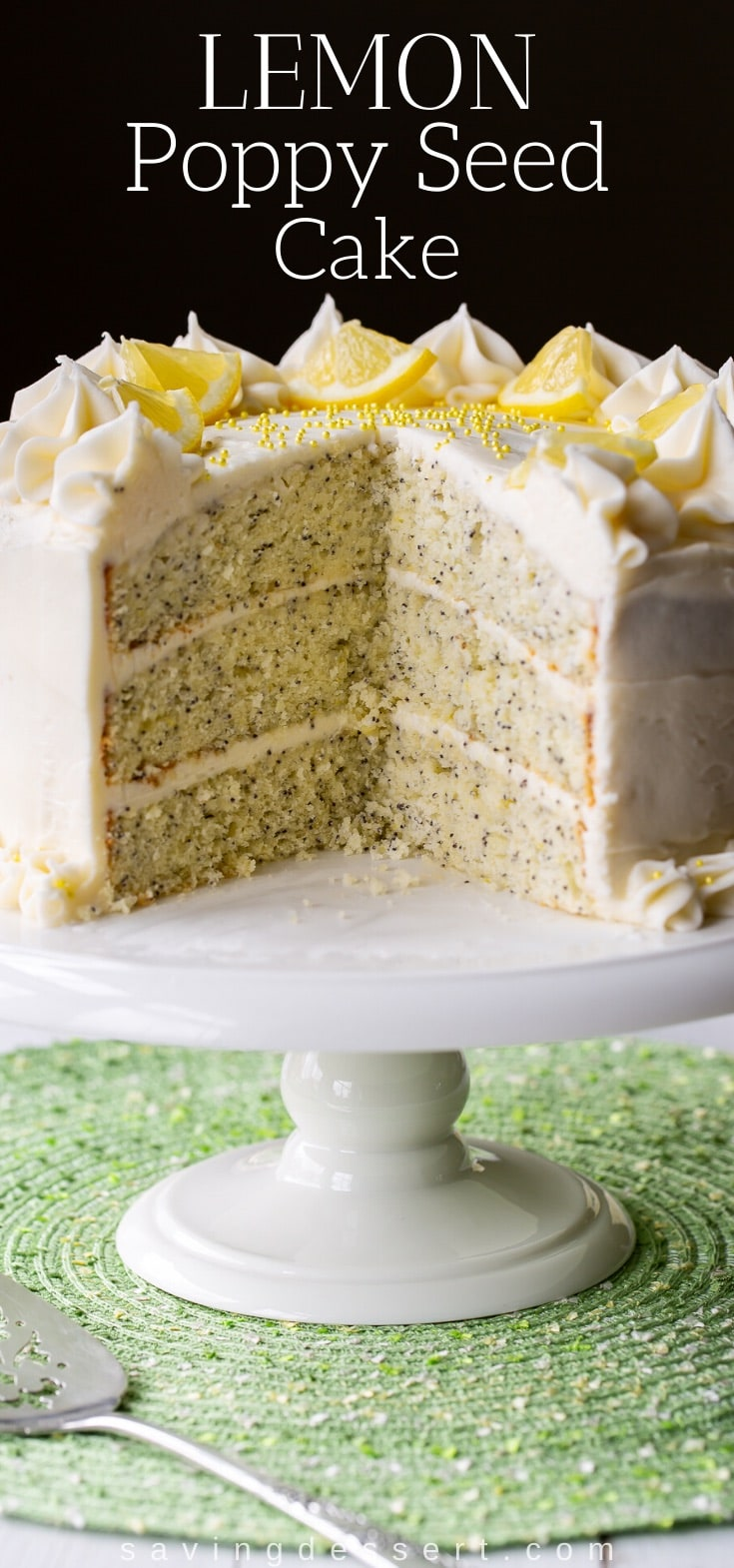 A sliced lemon poppy seed cake with three layers and lemon cream cheese frosting on a cake stand