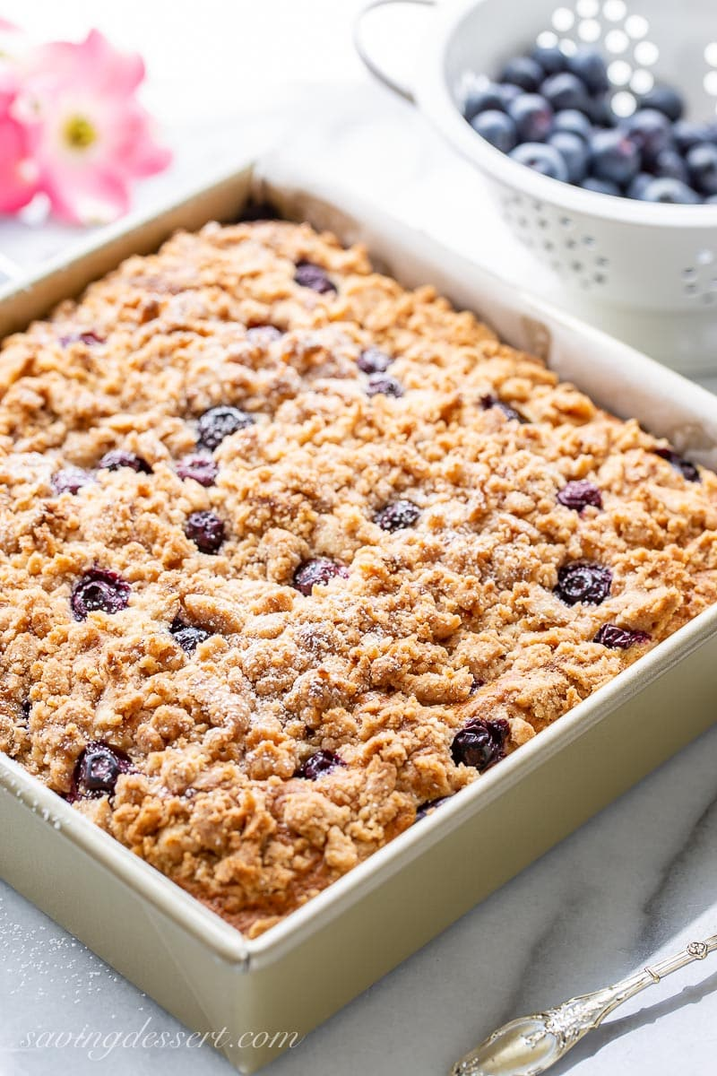 A pan with streusel topped blueberry coffee cake