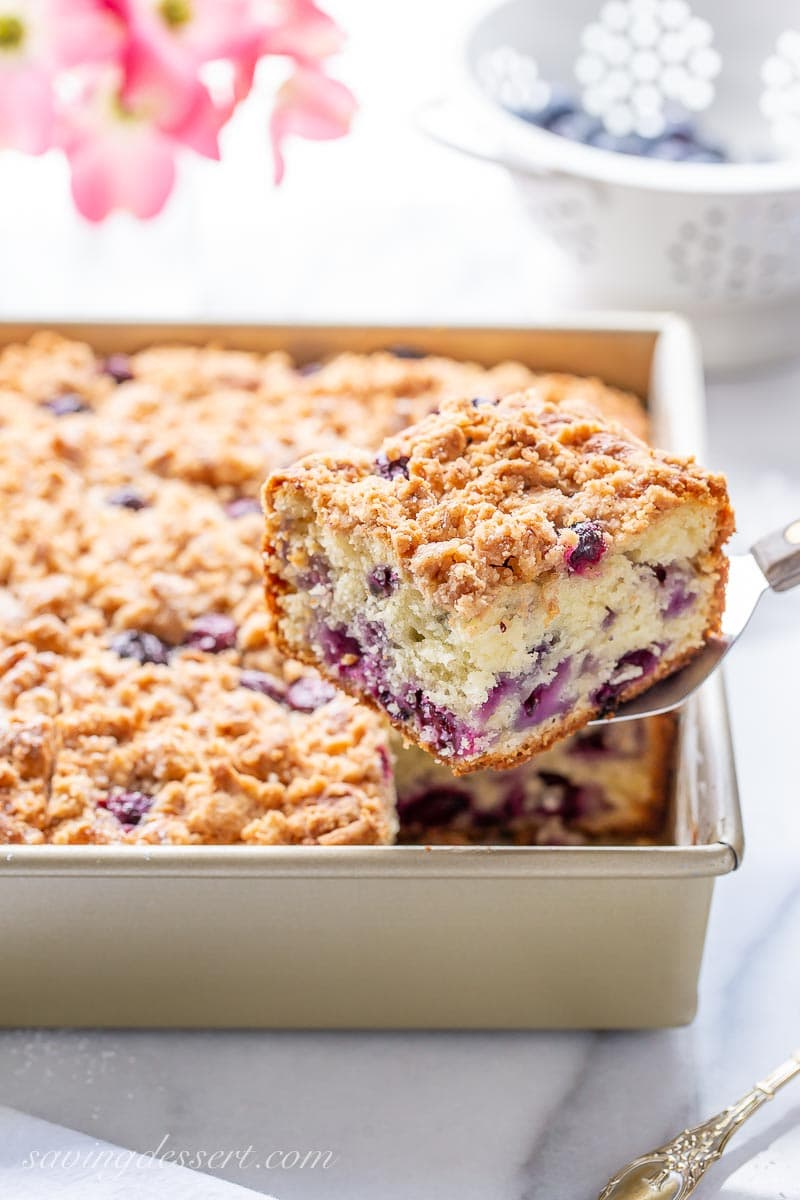A sliced blueberry coffee cake with streusel topping