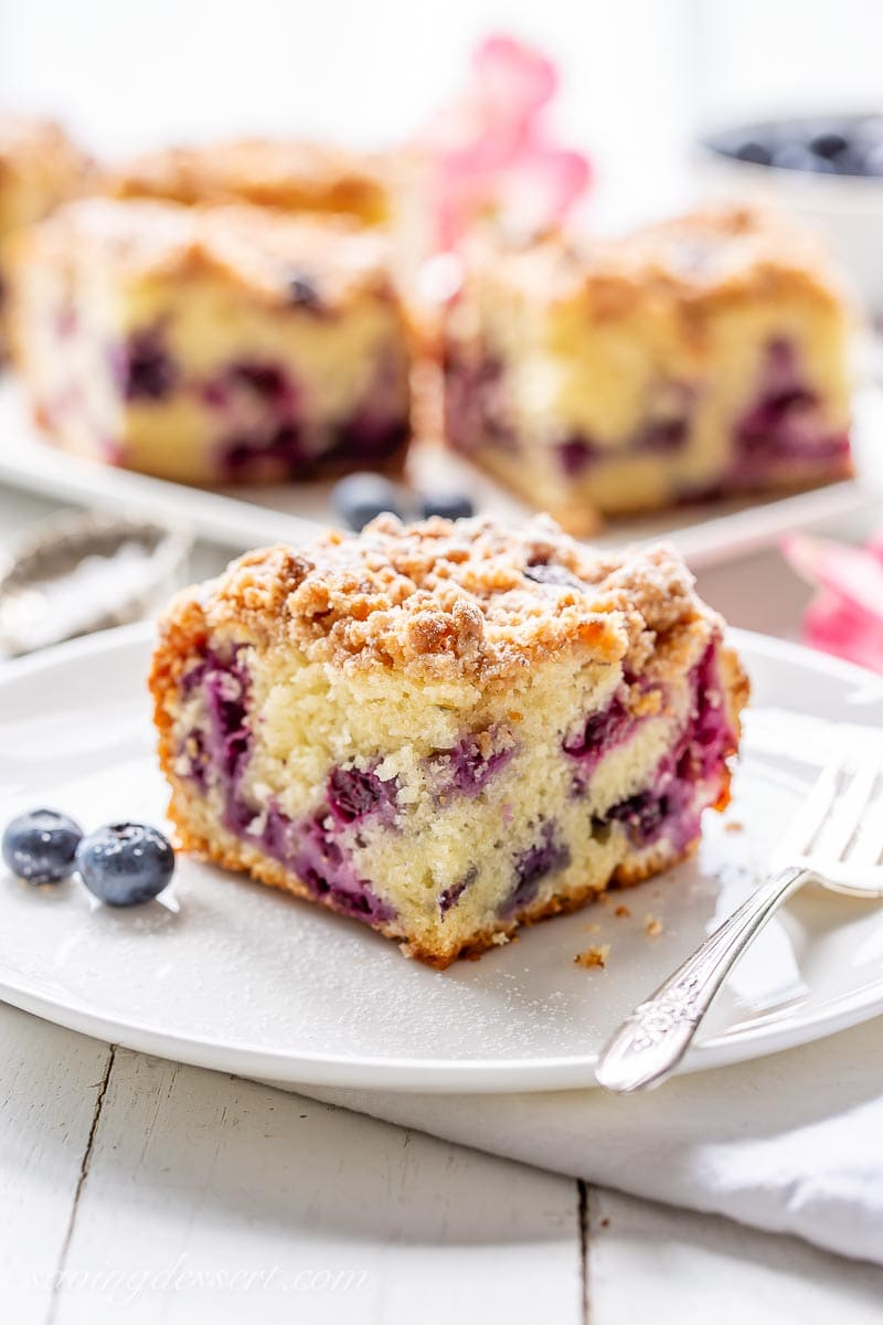 A square of coffee cake with blueberries