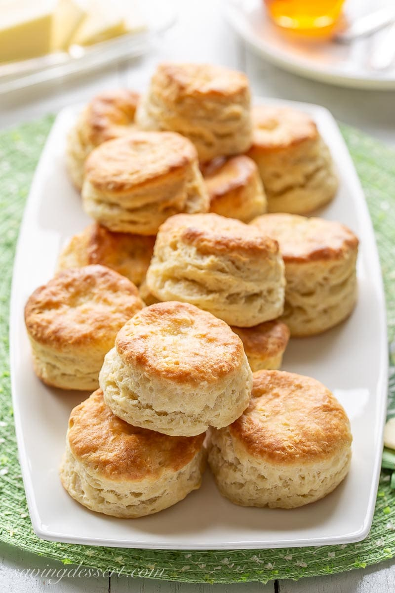 A platter stacked with flaky homemade biscuits