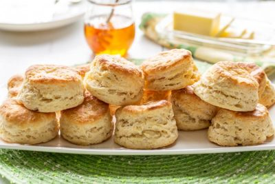 A platter of stacked buttermilk biscuits