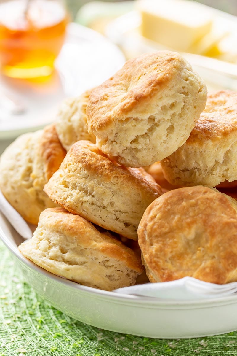 A bowl filled with fresh, hot buttermilk biscuits