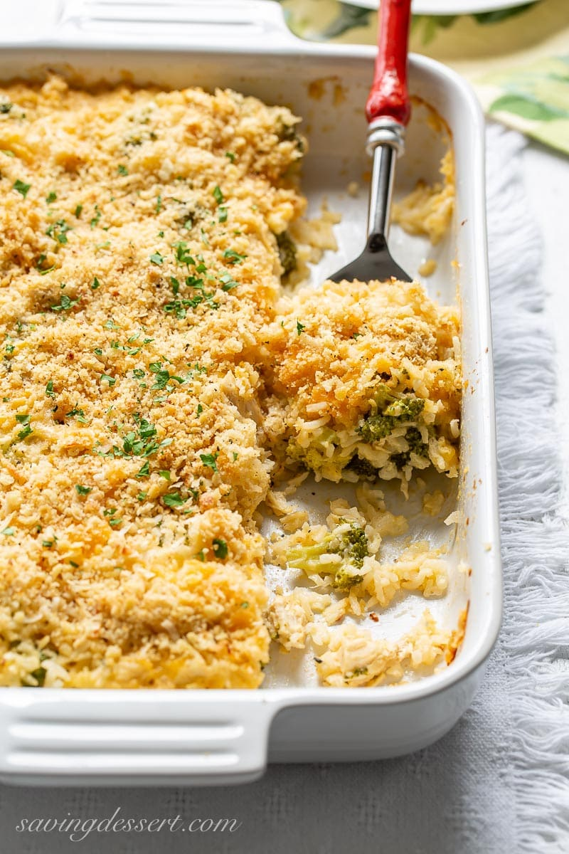 A casserole dish with a scoop of chicken and broccoli