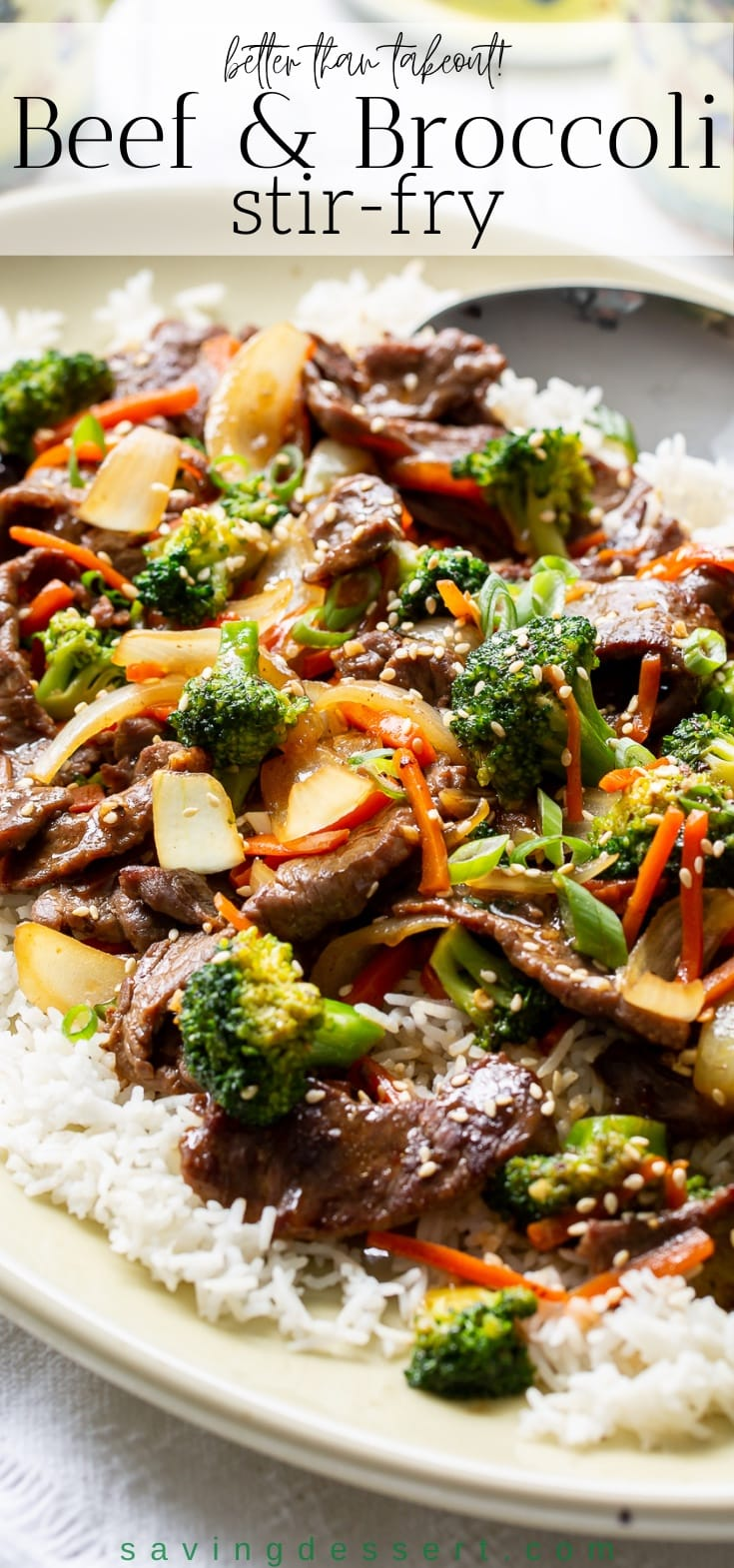 A platter with rice, beef and broccoli stir-fry garnished with sesame seeds