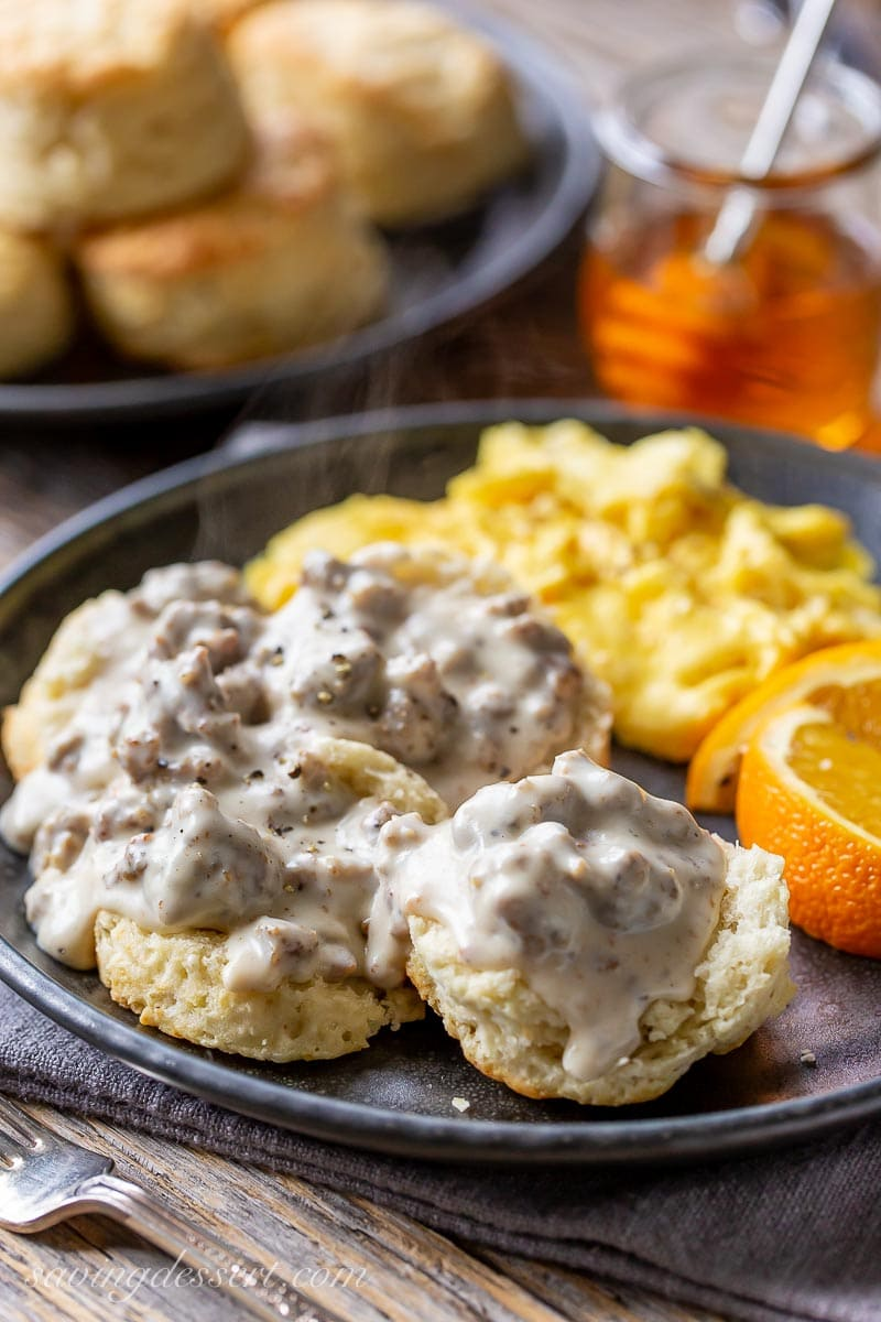 A plate with biscuits covered in hot country-style sausage gravy