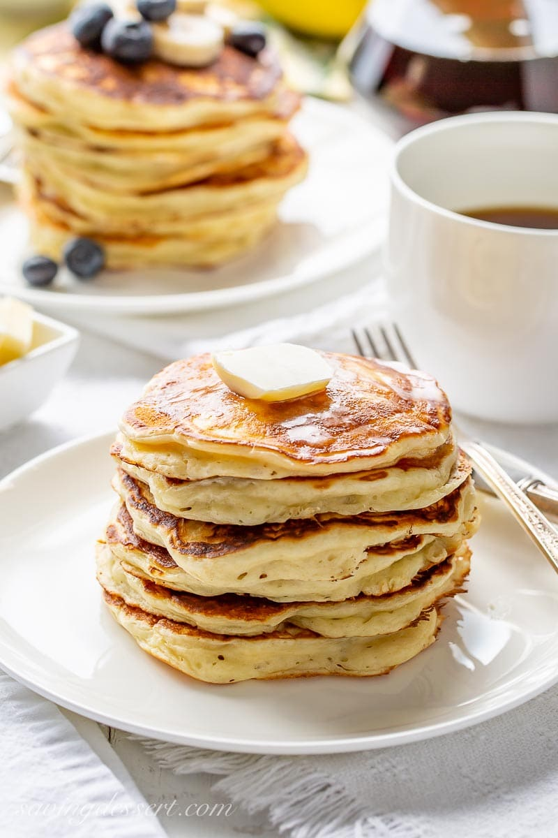A stack of buttermilk pancakes with a pat of butter on top