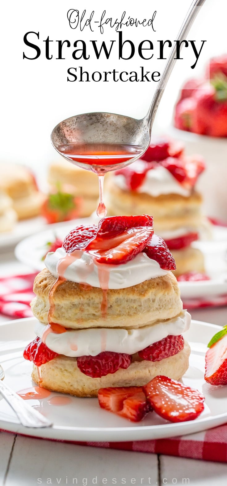 Strawberry syrup drizzled over a stacked strawberry shortcake