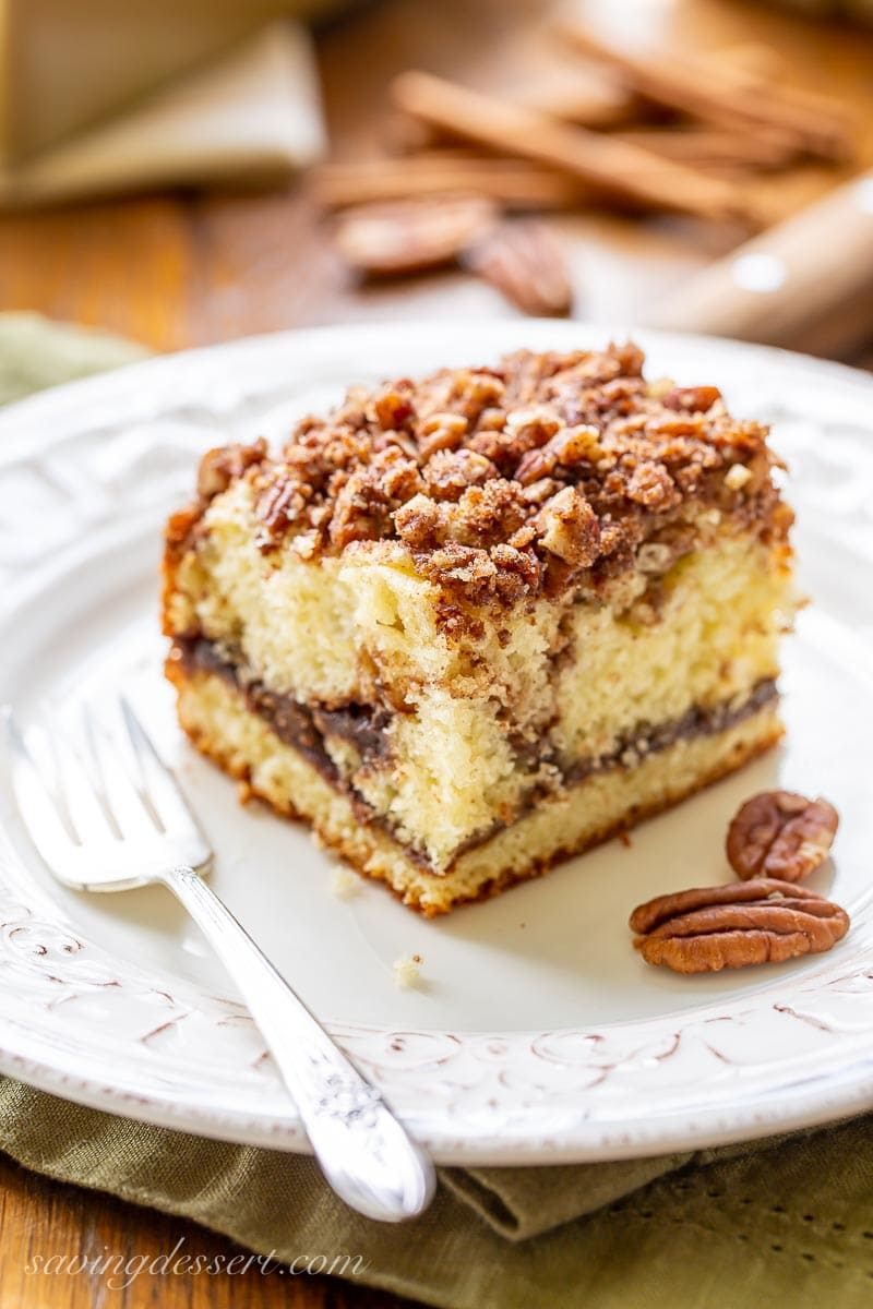 A square piece of cinnamon pecan coffee cake on a plate