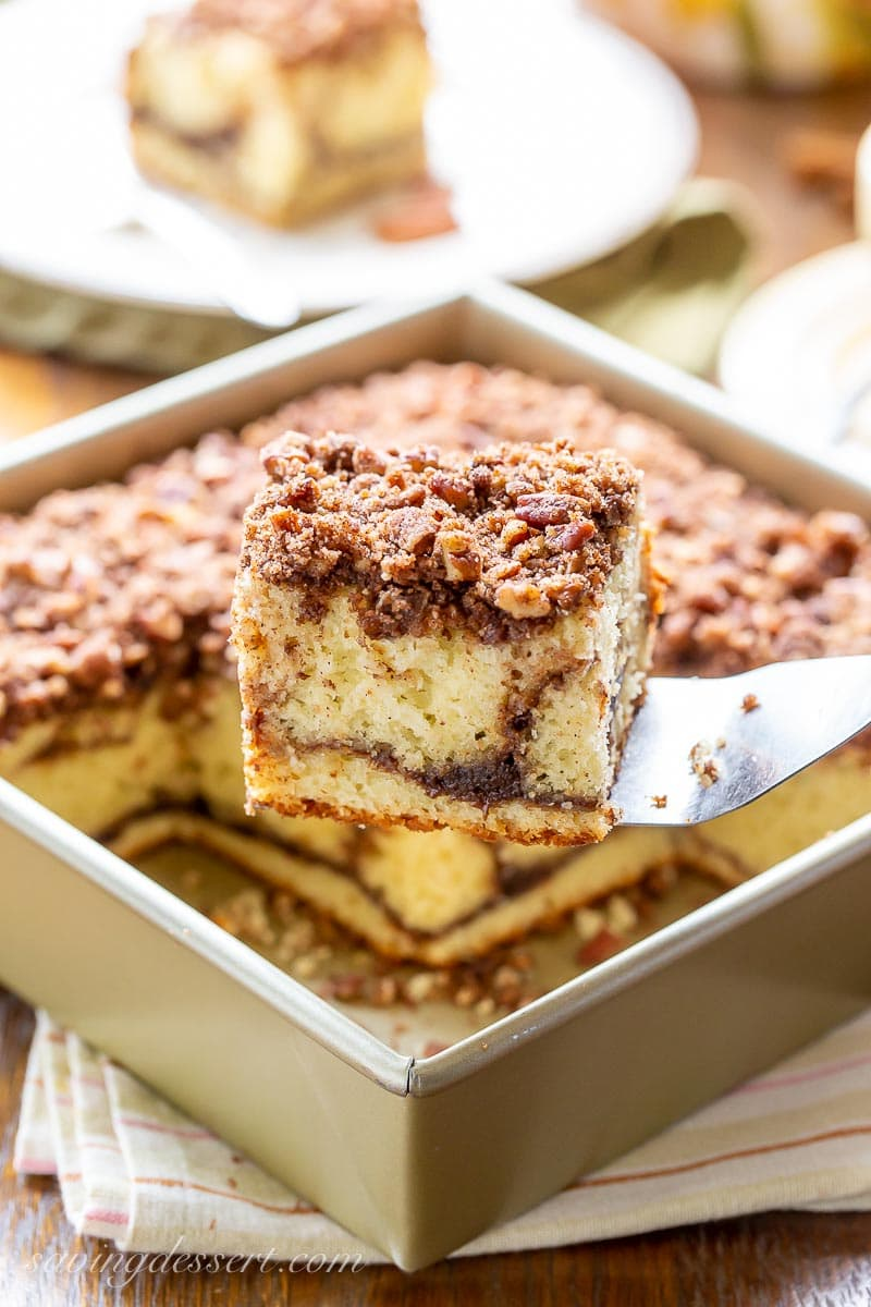 A square pan with a piece of coffee cake on a spatula