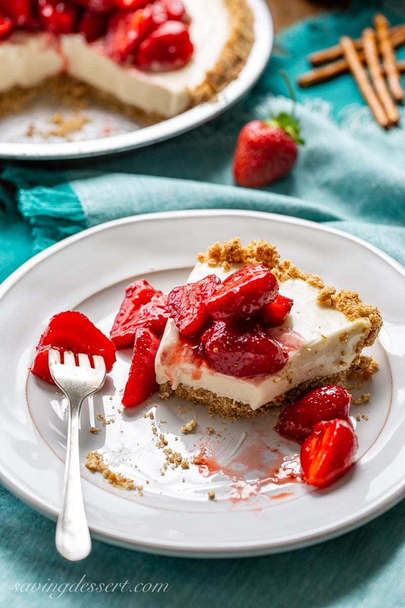 A slice of cream cheese pie topped with strawberries