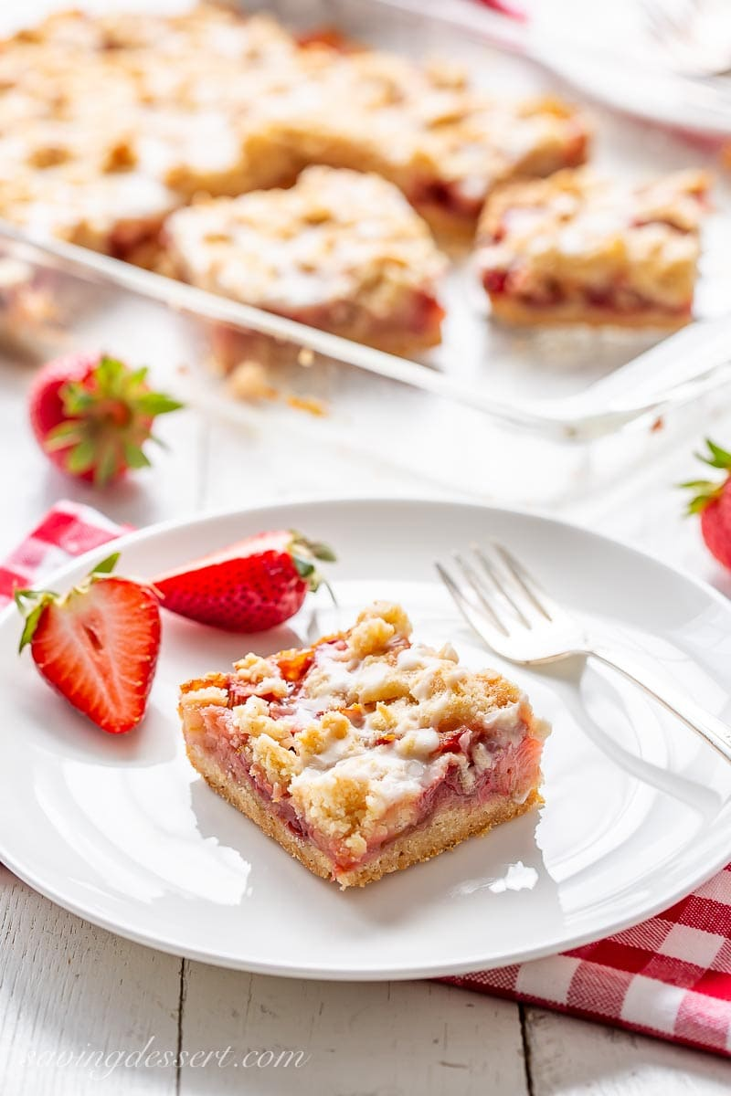 A plate with a square of strawberry rhubarb crumble bars