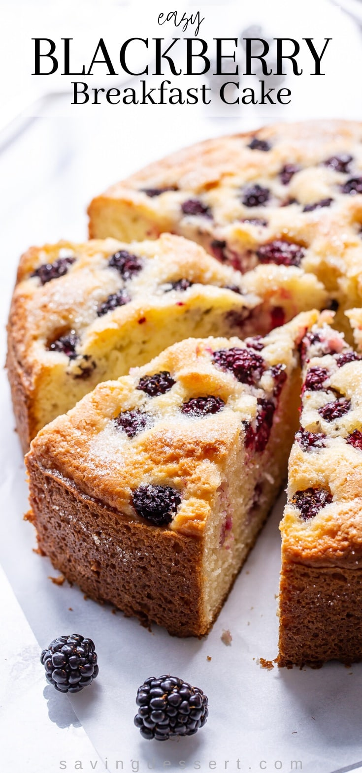 A side view of a blackberry breakfast cake sliced into individual servings