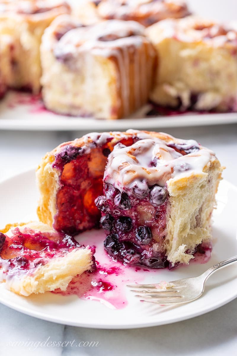 A unrolled sweet roll showing the blueberry filling and the flaky yeast roll
