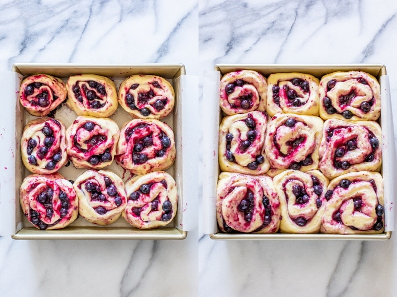 Two square pans of unbaked blueberry sweet rolls, one when first assembled, and the second showing the rolls after a long rise time