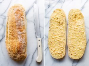 A loaf of Italian bread whole and sliced in half and buttered