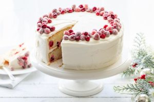 A Cranberry Christmas Cake on a cake stand