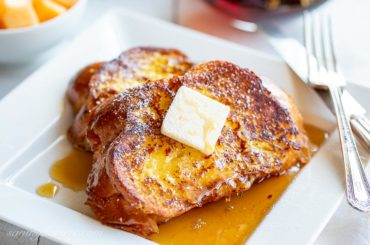 A close up of butter topped slices of French toast