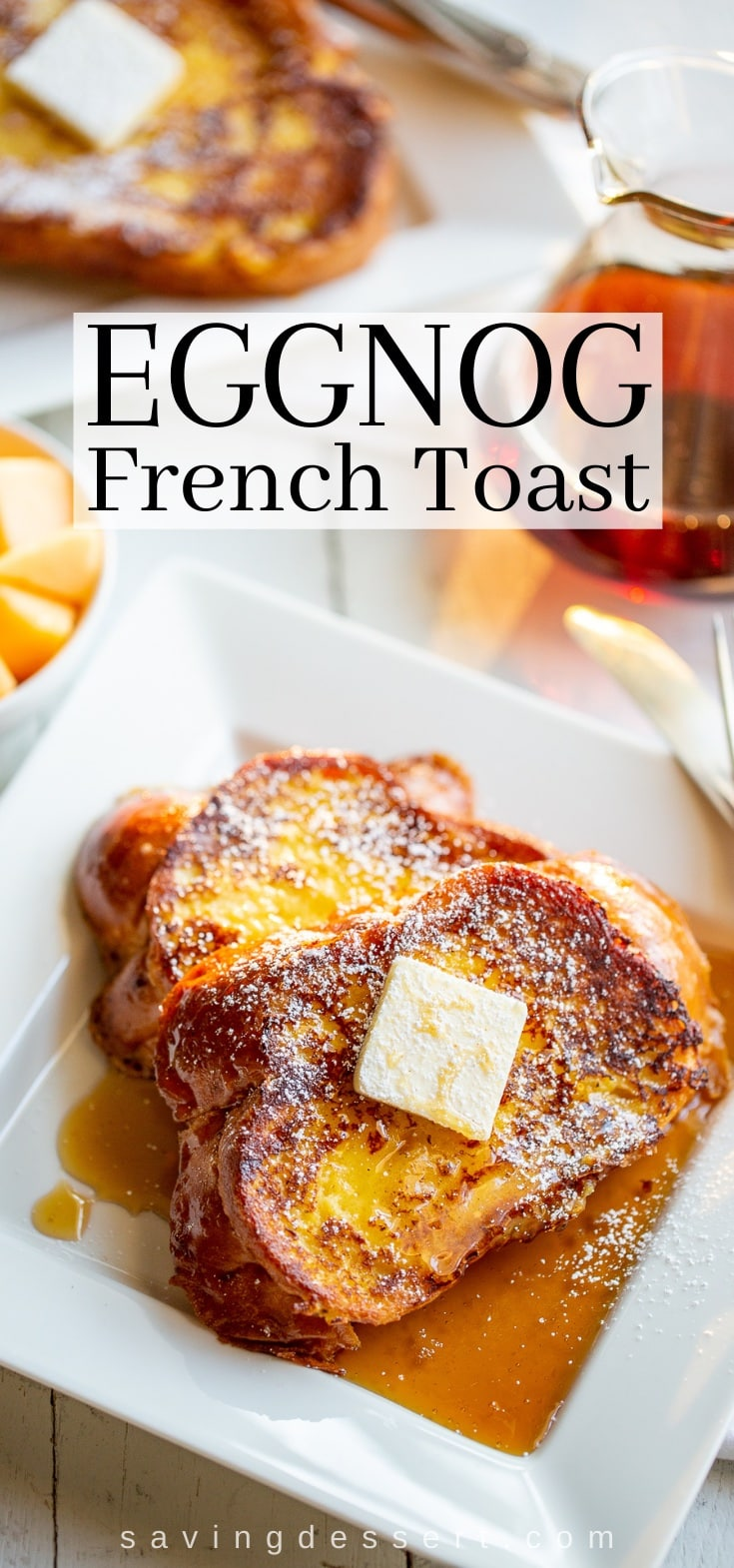 A plate of eggnog French toast with a pat of butter on top