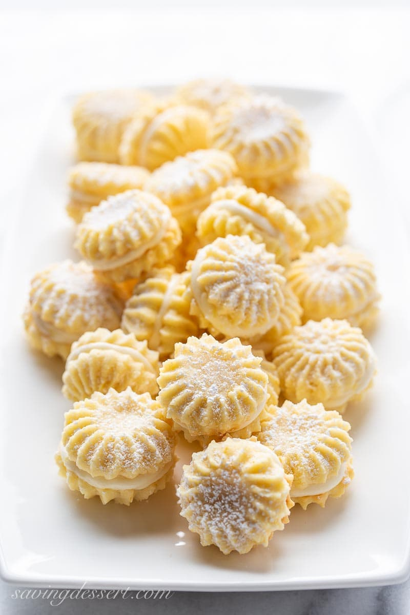 Lemon Cookies with lemon cream filling on a platter
