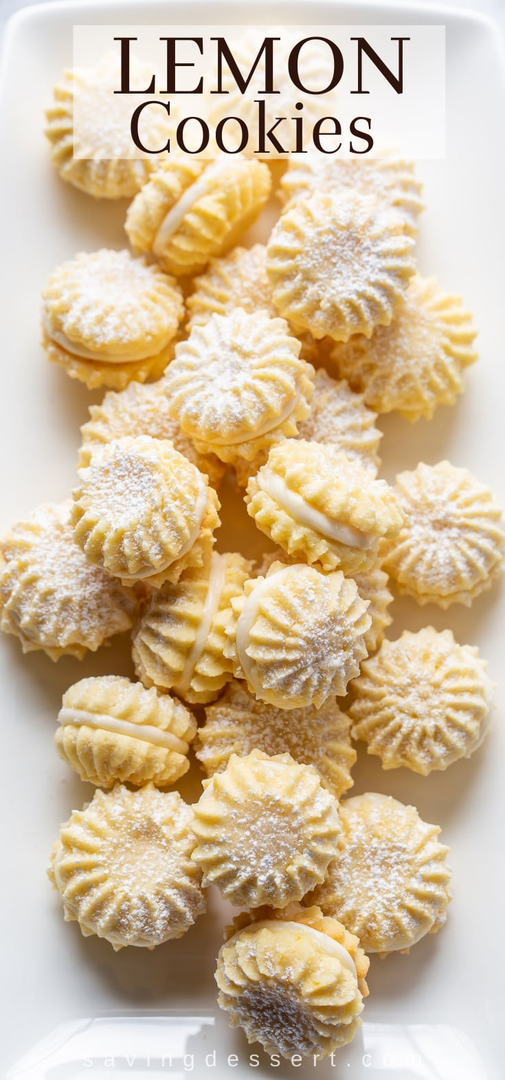 A platter of pretty piped lemon cookies with a lemon cream filling