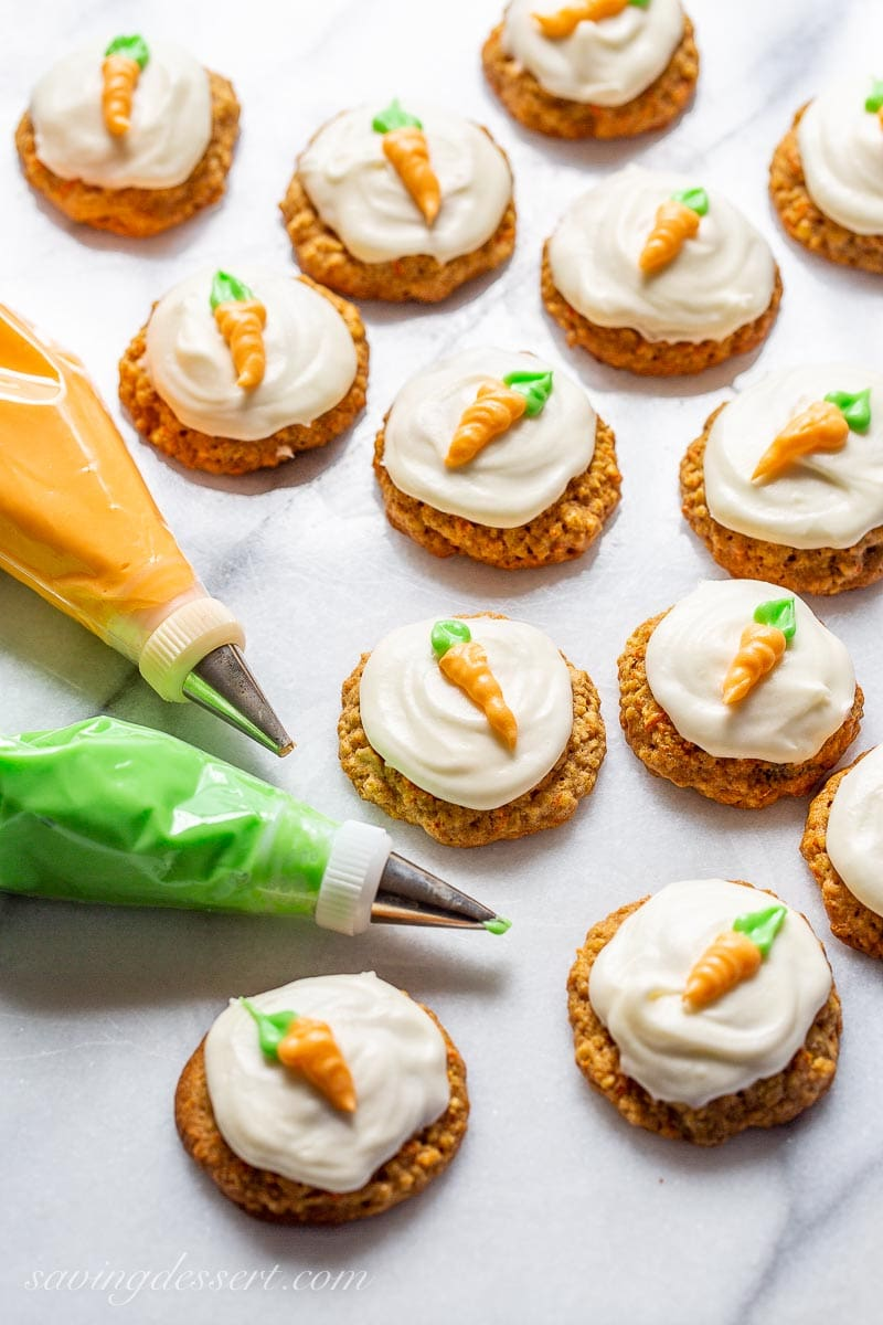 Carrot cake cookies decorated with piped carrots