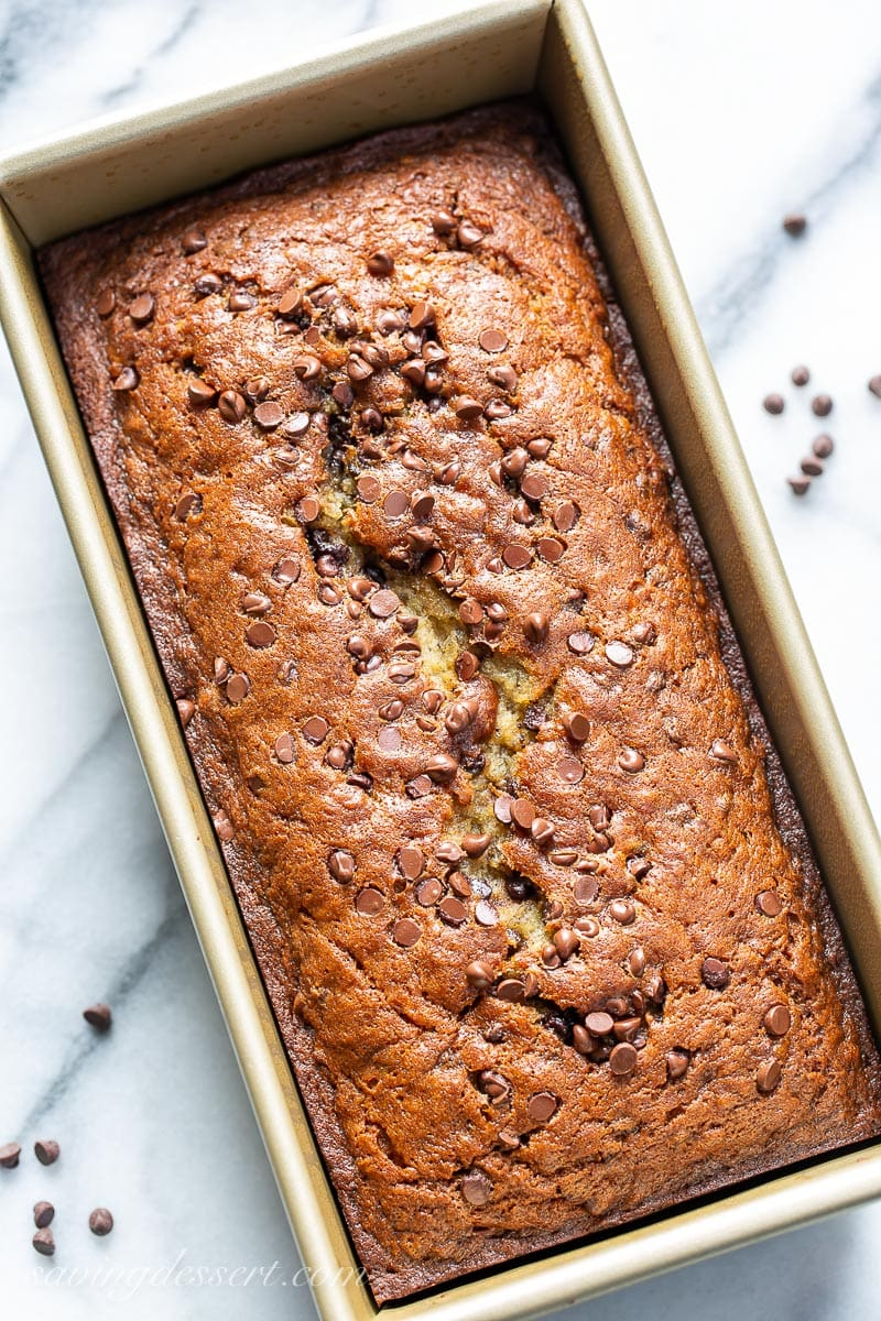 A golden brown loaf of quick bread sprinkled with mini chocolate chips