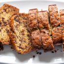 Overhead view of a platter of sliced banana bread with chocolate chips