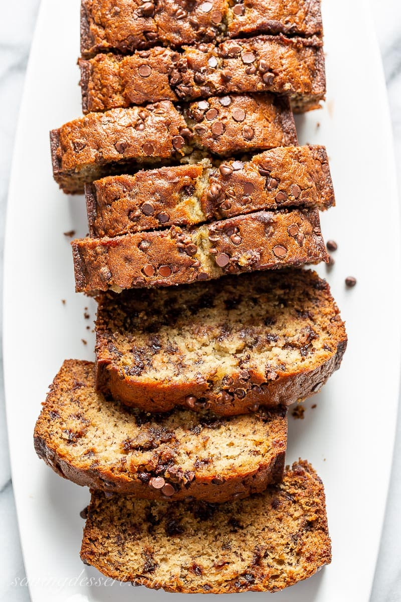 An overhead view of a platter of sliced chocolate chip banana bread