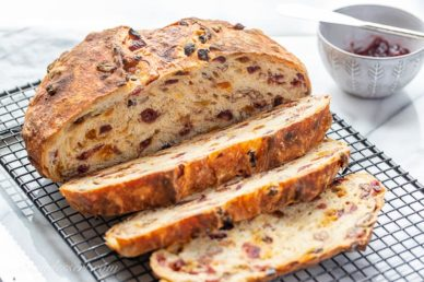 A sliced loaf of cranberry raisin bread