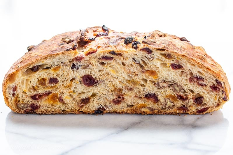 Harvest Bread sliced in half showing raisins and cranberries