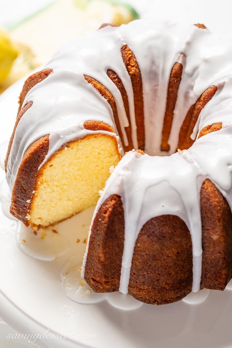 A sliced lemon cake drizzled with icing