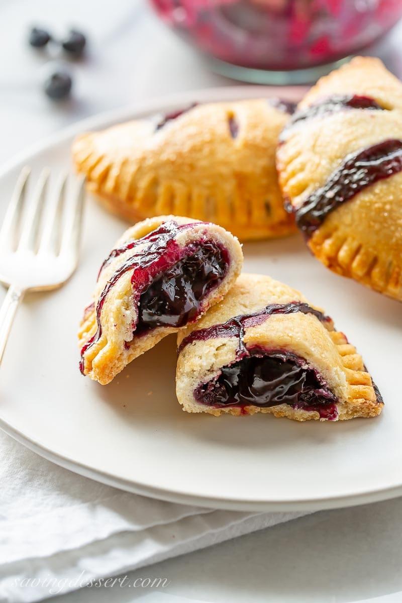 Blueberry hand pie broken open showing a jammy filling
