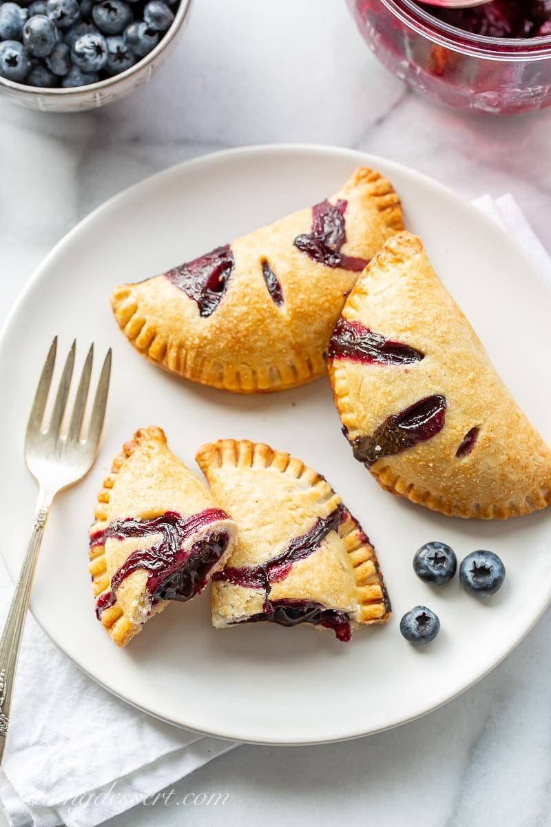 A dessert plate filled with blueberry pastries